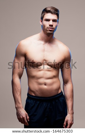 Portrait of a muscular very fit handsome young man.