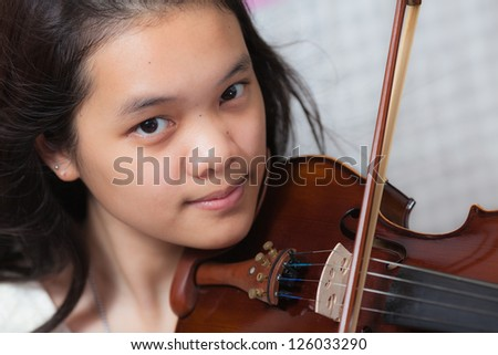 Portrait of a musician girl - stock photo
