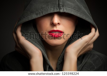 Portrait of a mysterious woman - stock photo