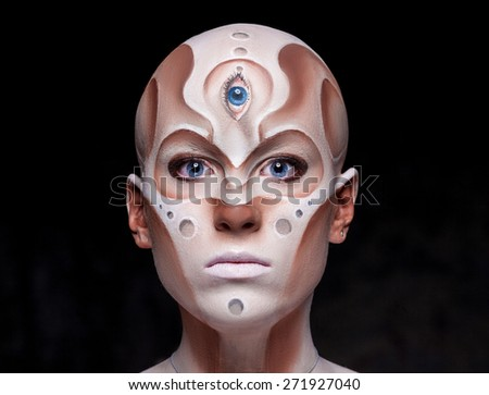 Portrait of a mysterious woman with a fantastic makeup Alien - stock photo