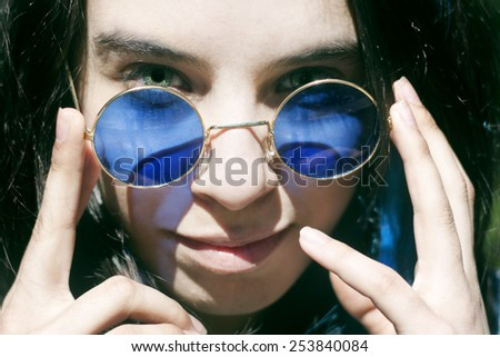 Portrait of a mystery woman in sunglasses. - stock photo