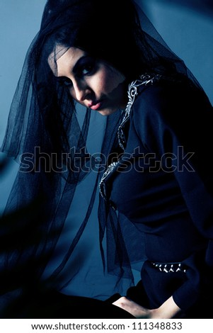 Portrait of a mystical  woman in an elegant black dress