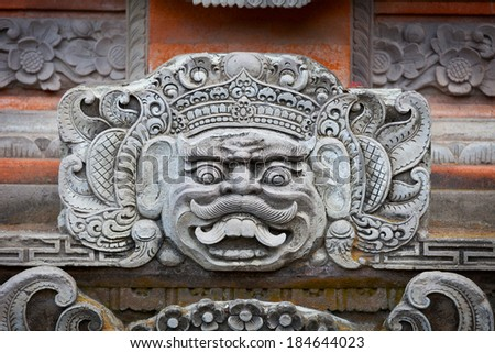 Portrait of a mythical character on the wall of the temple of the Indonesian