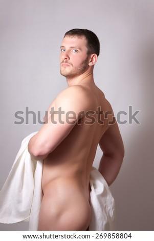 Portrait of a naked man, studio shot - stock photo