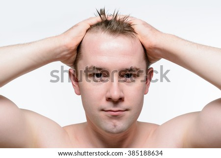 Portrait of a naked man with wet tousled hair