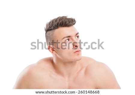 Portrait of a naked, muscular, young and handsome male model with copy space on white background - stock photo
