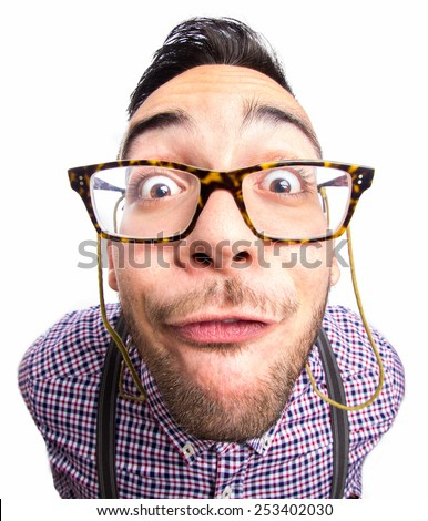 Portrait of a nerd with funny face - stock photo
