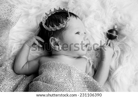 Portrait of a newborn baby boy with a crown ( black and white ) - stock photo