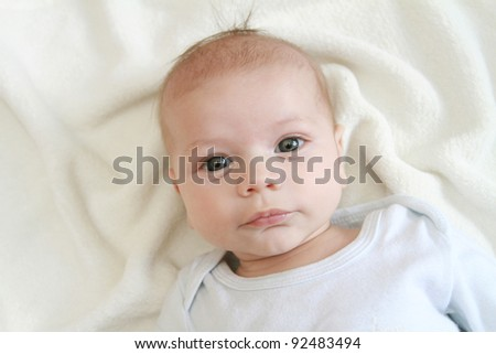Portrait of a newborn baby's face on blanket