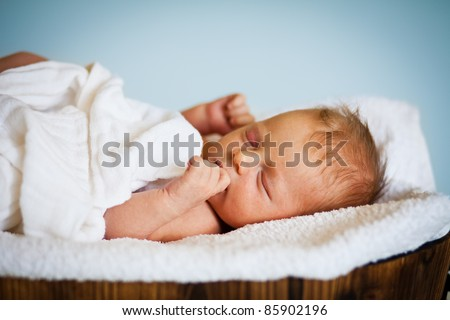 Portrait of a newborn caucasian girl - stock photo