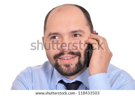 portrait of a nice adult businessman with phone on a white