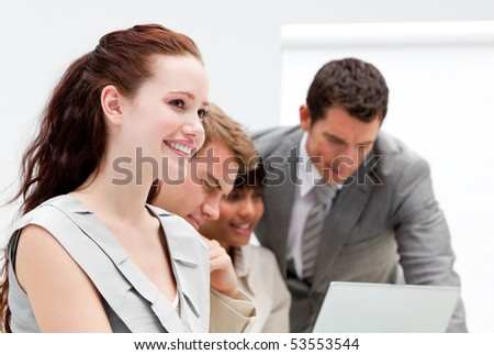 Portrait of a nice business team working together in the office