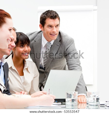 Portrait of a nice businesswoman working with her colleagues in the office