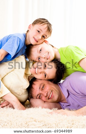 portrait of a nice family in the room - stock photo