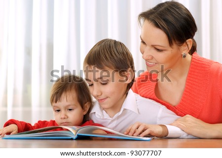 portrait of a nice family reading at table