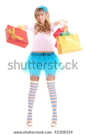 portrait of a nice girl in funny socks with holiday bags