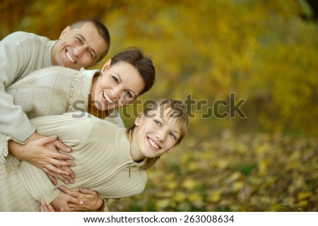 Portrait of a nice happy family in autumn park