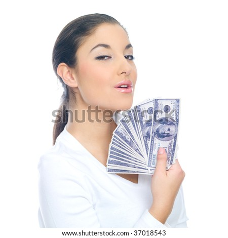 Portrait of a nice looking woman holding bunch of banknotes