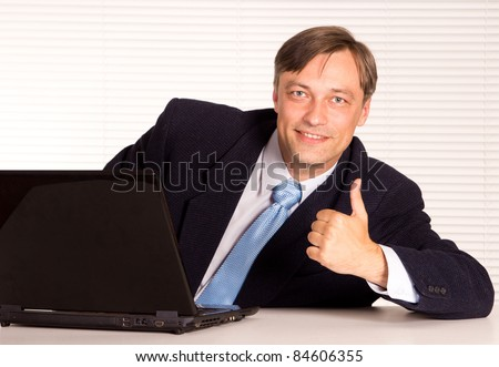 portrait of a nice man with computer