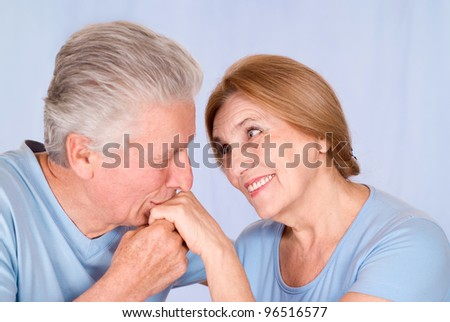 portrait of a nice old couple on blue background