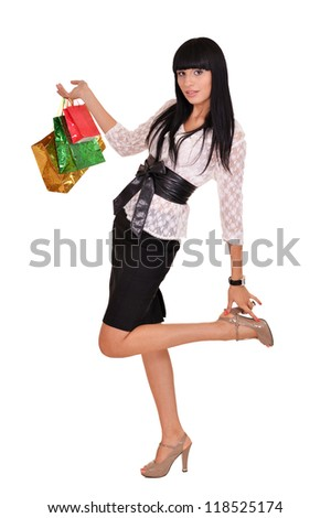 portrait of a nice woman with packages on a white - stock photo