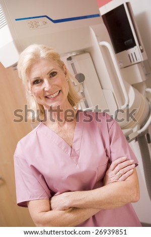 Portrait Of A Nurse In Front Of A Mammogram Machine - stock photo