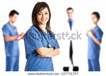 Portrait of a nurse in front of her medical team
