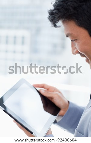 Portrait of a office worker using a tablet computer in his office