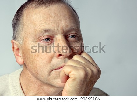 portrait of a  old man with serious depression. - stock photo