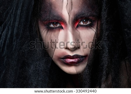 Portrait of a pale gothic vampire woman. Halloween Make up. - stock photo