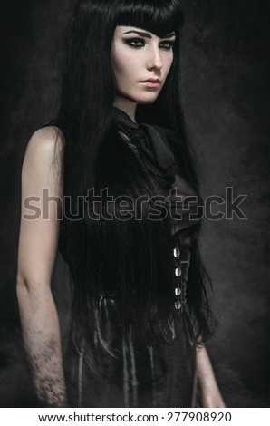 Portrait Of A Pale Gothic Woman In Black