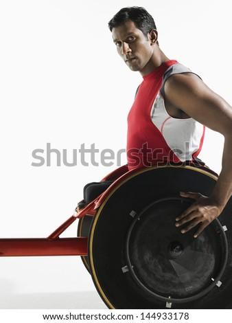 Portrait of a paraplegic cycler against white background - stock photo
