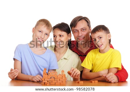 portrait of a parents and sons playing