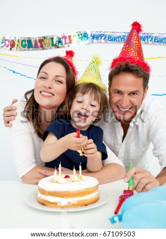 Portrait of a parents celebrating little their son's birthday