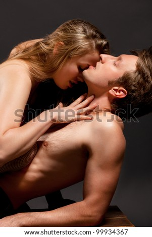Portrait of a passionate couple, over grey background