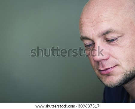 Portrait of a pensive bald man. Toned