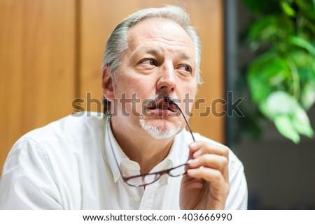 Portrait of a pensive businessman - stock photo