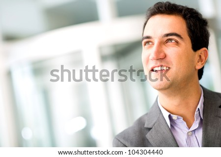 Portrait of a pensive businessman at the office - stock photo