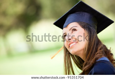 Portrait of a pensive female graduate looking up