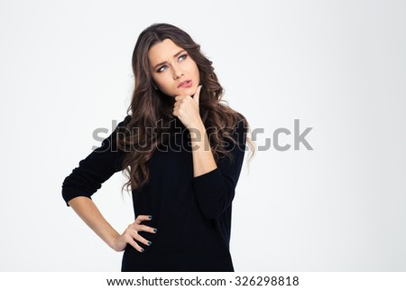 Portrait of a pensive girl looking up at copyspace isolated on a white background - stock photo