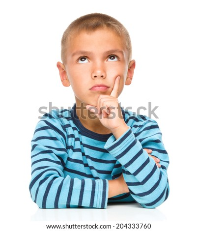 Portrait of a pensive little boy touching his cheek with index finger, isolated over white - stock photo