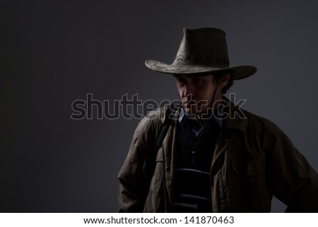 Portrait of a pensive man in a cowboy hat. Copy space for traveler