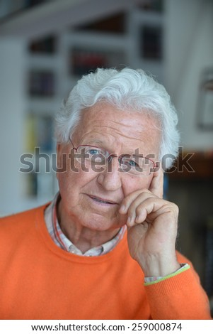 Portrait of a pensive man in his house - stock photo