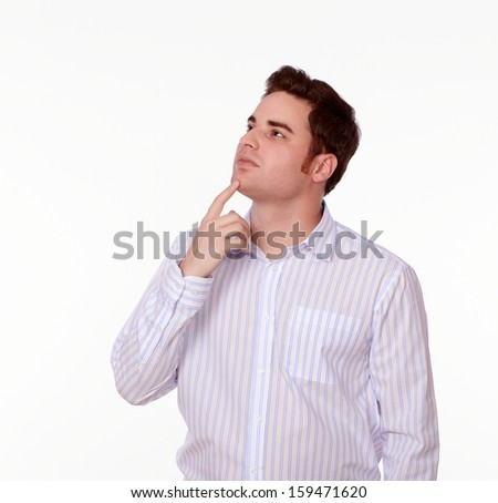 Portrait of a pensive man on white shirt standing on isolated background - copyspace