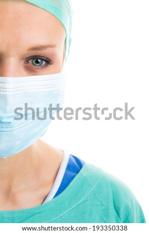 Portrait of a pensive/sad/exhausted female doctor/surgeon on white background