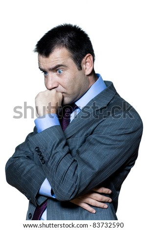 Portrait of a pensive shocked businessman in studio on isolated white background - stock photo