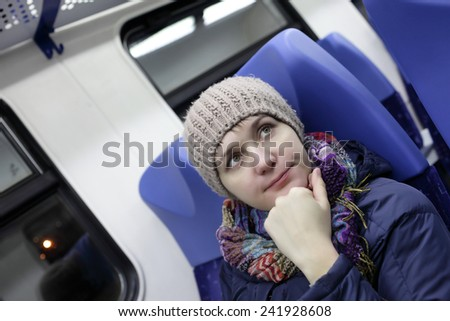 Portrait of a pensive woman in a train