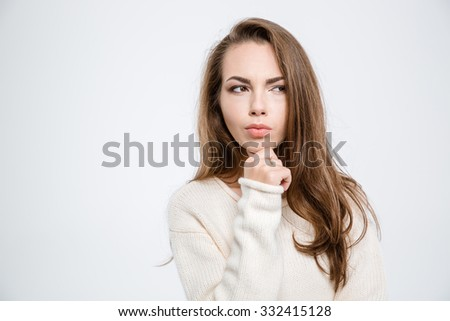 Portrait of a pensive woman looking away isolated on a white background - stock photo