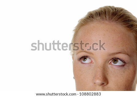 portrait of a pensive woman. looking up. isolated against a white background.