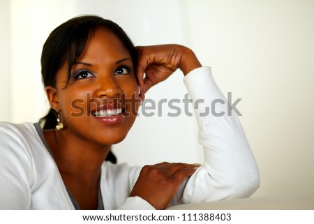 Portrait of a pensive young woman looking up at soft colors composition